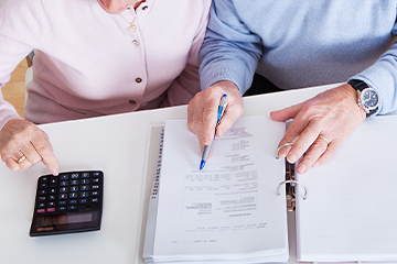 Home care couple doing paperwork - 360x240