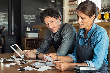 Man and Woman looking at bills or tax Thumb 360 x 240