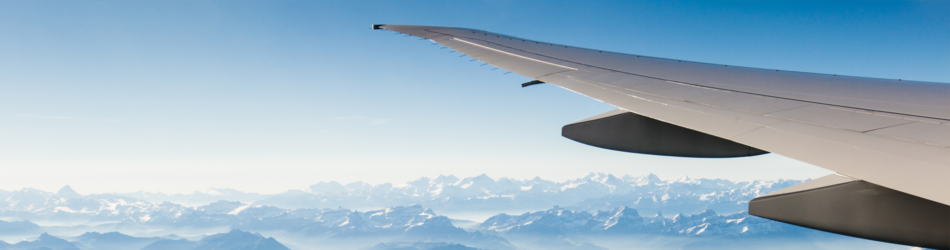 Travel Plane background mountains 1900x500