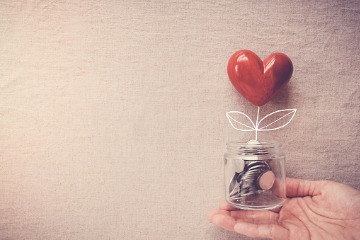 hand-holding-a-jar-of-heart-tree-growing-on-money-coins-social 360 x 240