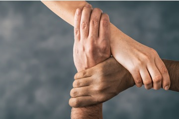 top-view-of-holding-hands-concept-of-unity-teamwork-and-support-picture 360 x 240
