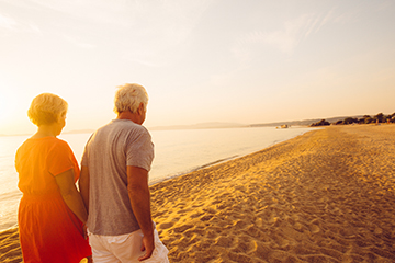 retirement couple on beach - web thumb